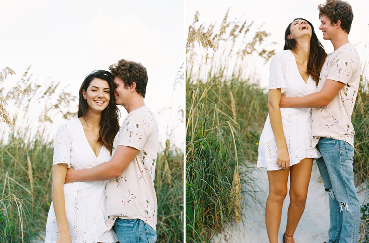 Couple hugging and laughing on the beach dunes